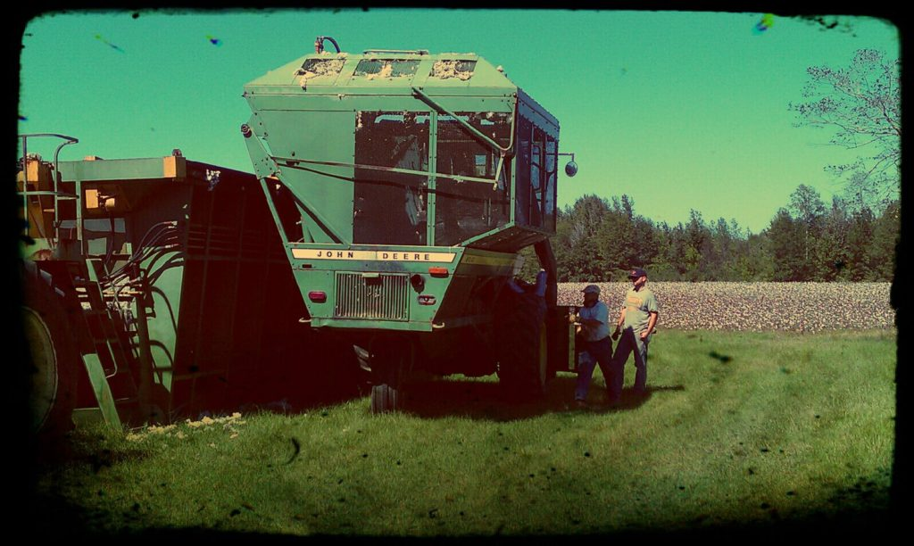 Clyde and Joe working on a cotton picker